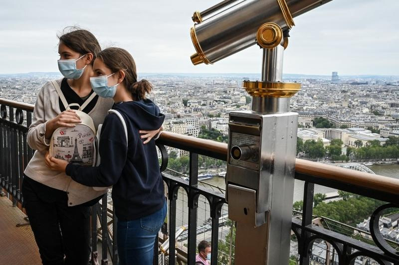 France opens doors to vaccinated travellers, restricts others