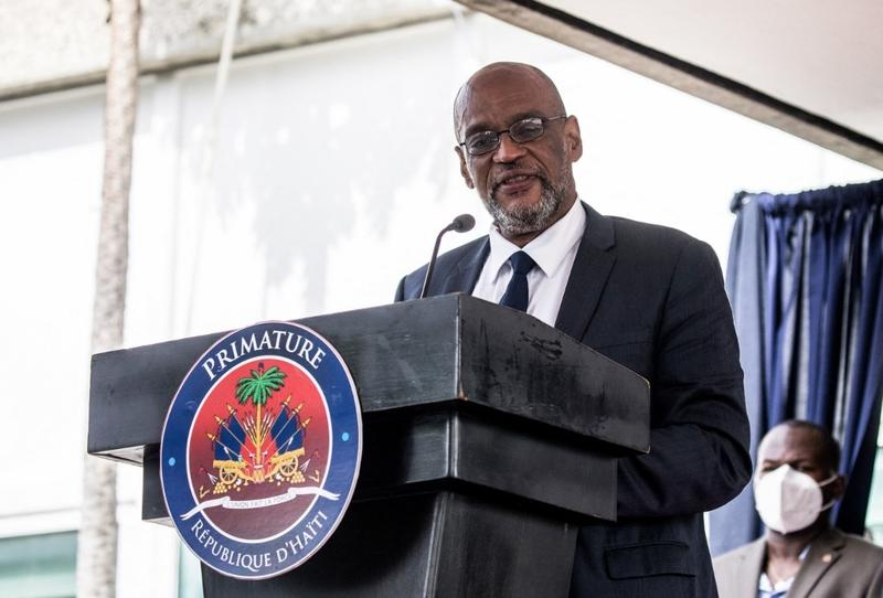 Haiti PM, suspect in murder of president, replaces justice chief