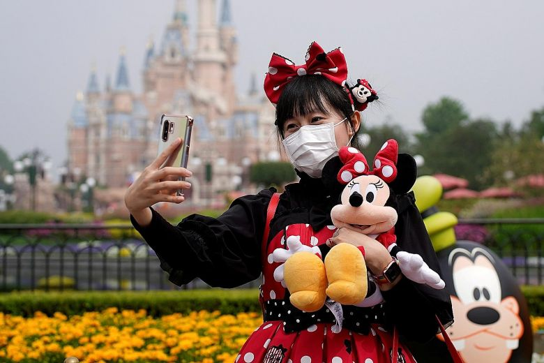 Walt Disney Co's theme parks in Shanghai (above), Hong Kong and Tokyo remain open. PHOTO: REUTERS