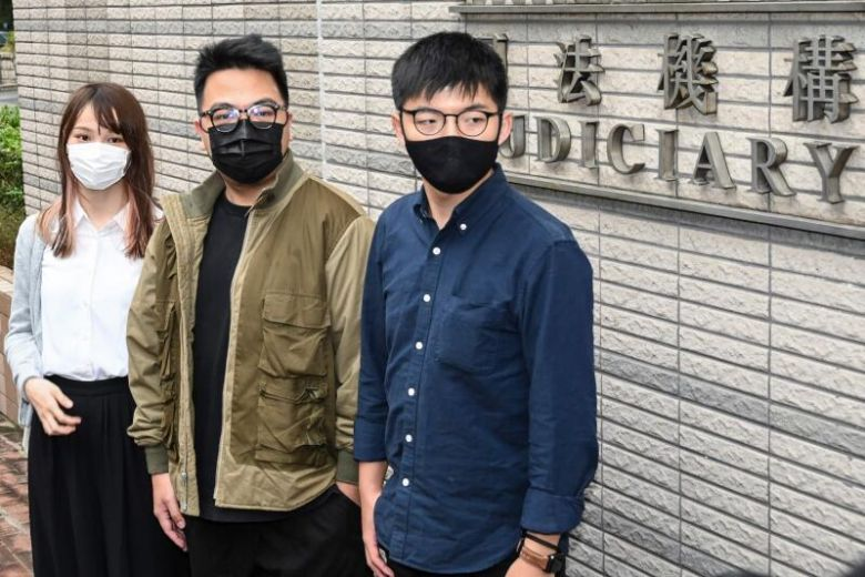 (From left) Activists Agnes Chow, Ivan Lam and Joshua Wong arrive for their trial at West Kowloon Magistrates Court in Hong Kong, on Nov 23, 2020.