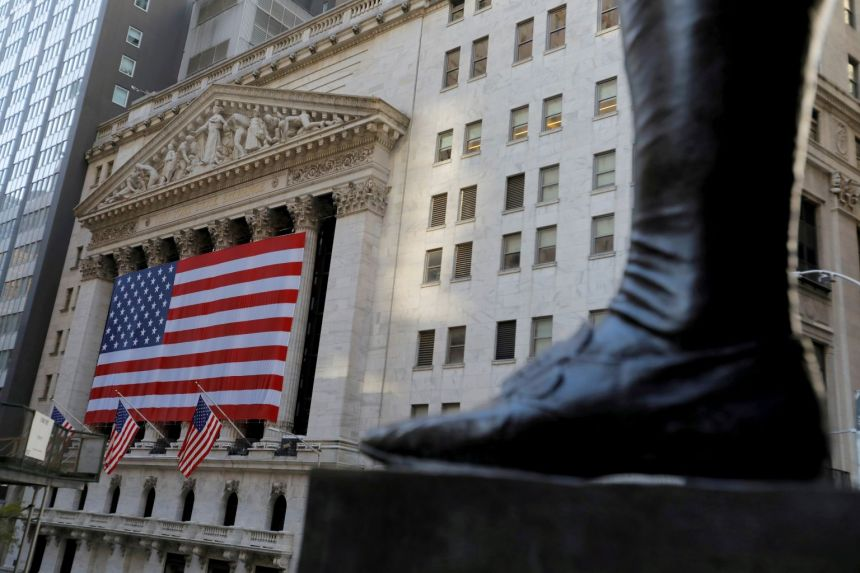 The boot on the statue of George Washington, the first US president, is seen across from the New York Stock Exchange.