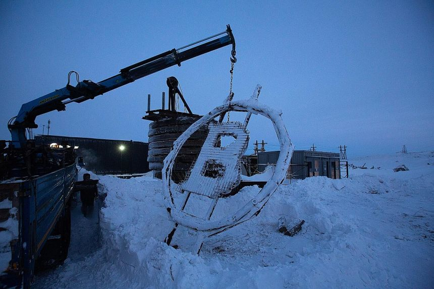A bitcoin sculpture made from scrap metal being installed outside the BitCluster cryptocurrency mining farm in Norilsk, Russia, last month. Bitcoin slid as much as 7.7 per cent to about US$28,818 in Asian trading before steadying just above US$30,000