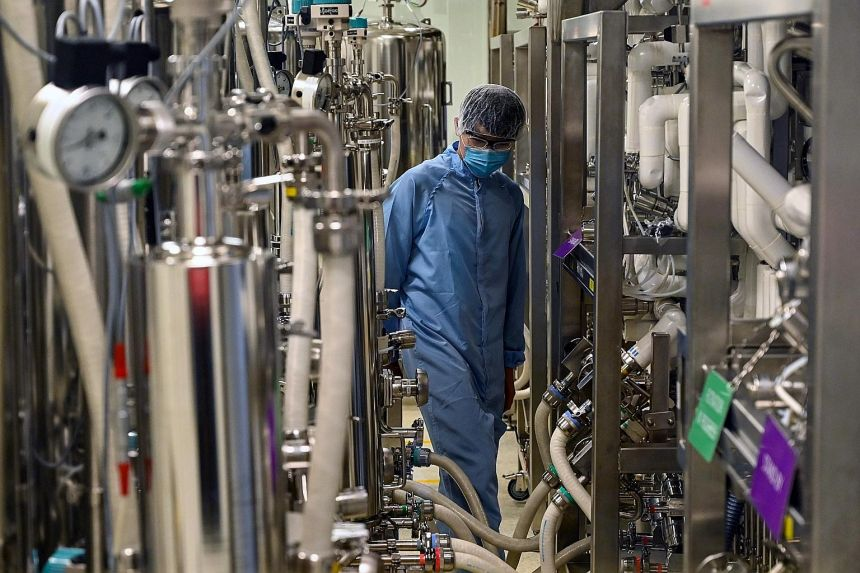 A biochemist in a buffer preparation room used for manufacturing medical products at Takeda Pharmaceuticals here. All manufacturing clusters anticipate better business prospects in the first half of this year, with the biomedical manufacturing cluste