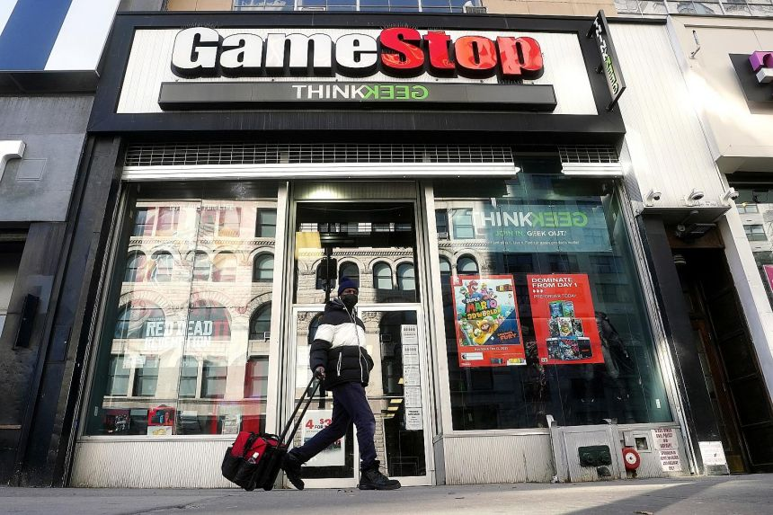 "A GameStop store in the Manhattan borough of New York City. The so-called ""Reddit rally"" has inflated stock prices for GameStop and other previously downtrodden firms that individual investors championed on social media forums such as Reddit's Wallst"