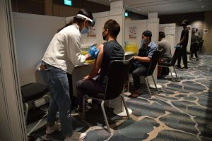 Hospitality staff receiving the Covid-19 vaccination at Raffles City Convention Centre on Jan 28, 2021.
