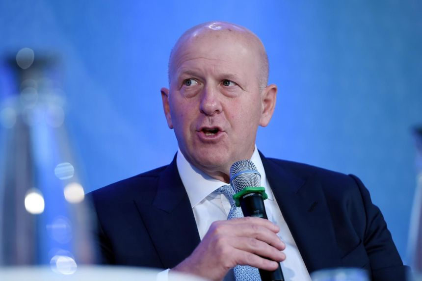 The board reduced David Solomon's package to US$17.5 million (S$23.2 million) for 2020.