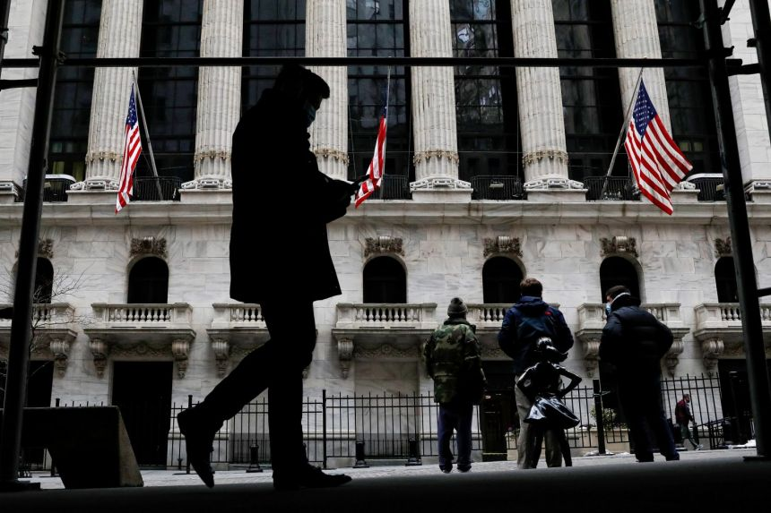 The Fearless Girl statue is seen outside the New York Stock Exchange, Feb 12, 2021.