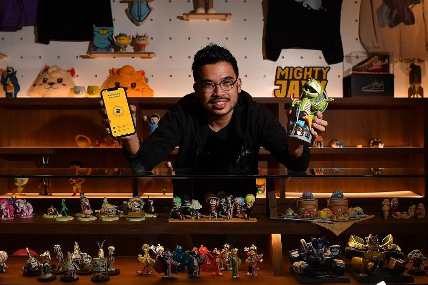 Mr Jackson Aw, founder of Mighty Jaxx which sells technology-enabled collectibles such as the XXRAY Plus Oscar the Grouch figurine that he is holding, tapped Enterprise Singapore's support to boost the firm's branding and marketing to reach more mult