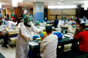The market in Central Jakarta was abuzz with excitement as 40 vaccinators made preparations for the inoculation.