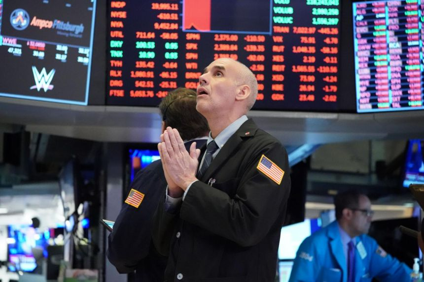 Traders work on the floor at the New York Stock Exchange on March 18, 2020.