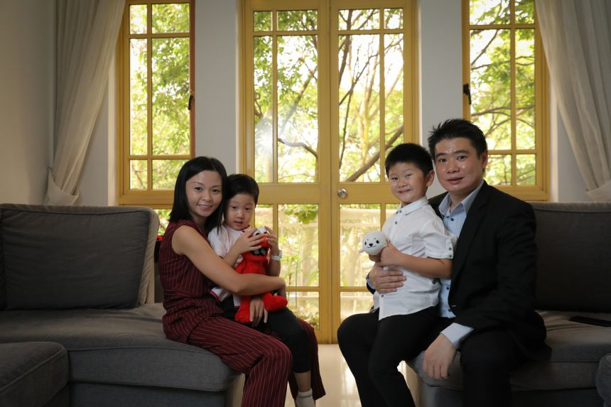 (From left) Ms Flavia Teo, Aiden and Ryden Koh, Mr Eugene Koh at their home - a three-bedroom apartment at the Villa Marina Condominium near East Coast Road which cost $1.13 million in 2011.