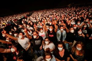 "People wearing protective masks attend a concert of ""Love of Lesbian"" at the Palau Sant Jordi in Barcelona, on March 27, 2021."