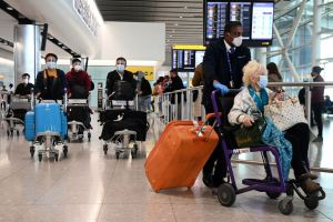 Travellers arrive at Heathrow Airport in London, on May 3, 2021.