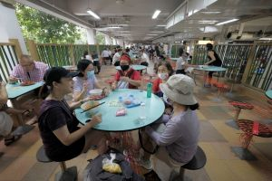 A group of five friends having breakfast at Hong Lim Food Centre after their morning walk on July 12, 2021.