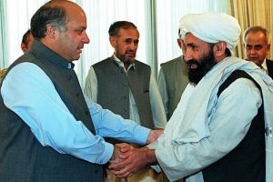 In this Aug 26, 1999, file photo, Pakistani Prime Minister Nawaz Sharif receives Afghan Foreign Minister, Mullah Hassan Akhund (right), in Islamabad.