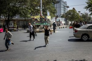 Protesters flee as Taliban forces fire their weapons into the air in Kabul, on Sept 7, 2021.