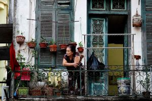 A woman looking out from the balcony of her home in Hanoi, during the government-imposed lockdown, on Sept 4, 2021.