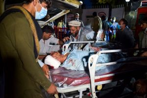 Medical and hospital staff bring an injured man on a stretcher for treatment after the blasts.