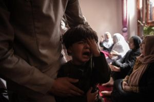 A boy cries in Kabul on  Aug 30, 2021, over the death of his sister in a US drone strike.