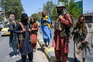 Taleban fighters stand guard along a street near the Zanbaq Square in Kabul on Aug 16, 2021.