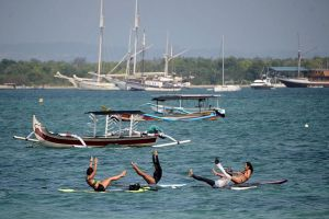 People doing yoga on paddle boards at Sanur beach in Bali last month.