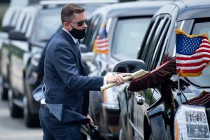 A US Secret Service agent dusts an armoured limousine while waiting for US President Joe Biden to arrive at Jimmy Carter Regional Airport in Americus, Georgia, on April 29, 2021.