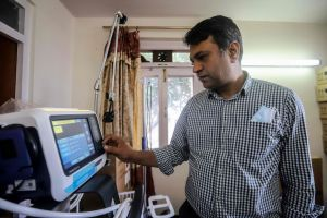 Nepal Ventilator Services co-founder Bishal Dhakal checks ventilators at a warehouse before they are rented out to hospitals treating Covid-19 patients in Kathmandu on June 14, 2021.