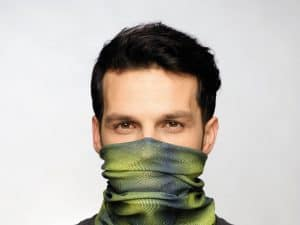 Cropped studio image. Man wearing a face mask. credit - 2011 copyright Original Buff S.A