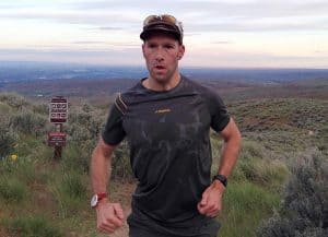 Steve Graepel trail running wearing a La Sportive Peak T-shirt. Source https://gearjunkie.com/gym-bag-stink-test-poligiene-treated-t-shirt