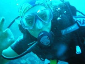 Frontal landscape shot of a female diver wearing a Arocsport Original Buff® as hair cover. The photo is taken underwater. The diver signals that she's fine. Source: Arocsport.com.au © Permission to use on our websitesFrontal landscape shot of a female diver wearing a Arocsport Original Buff® as hair cover. The photo is taken underwater. The diver signals that she's fine. Source: Arocsport.com.au © Permission to use on our websites