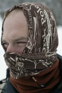 A portrait shot of a man wearing a Polar Buff® as a balaclava. It looks cold and he has the face mask part on in 2 layers. It's also obvious that he has very little hair. Source: buff.eu. Distributed for the promotion of the Polar Buff®.