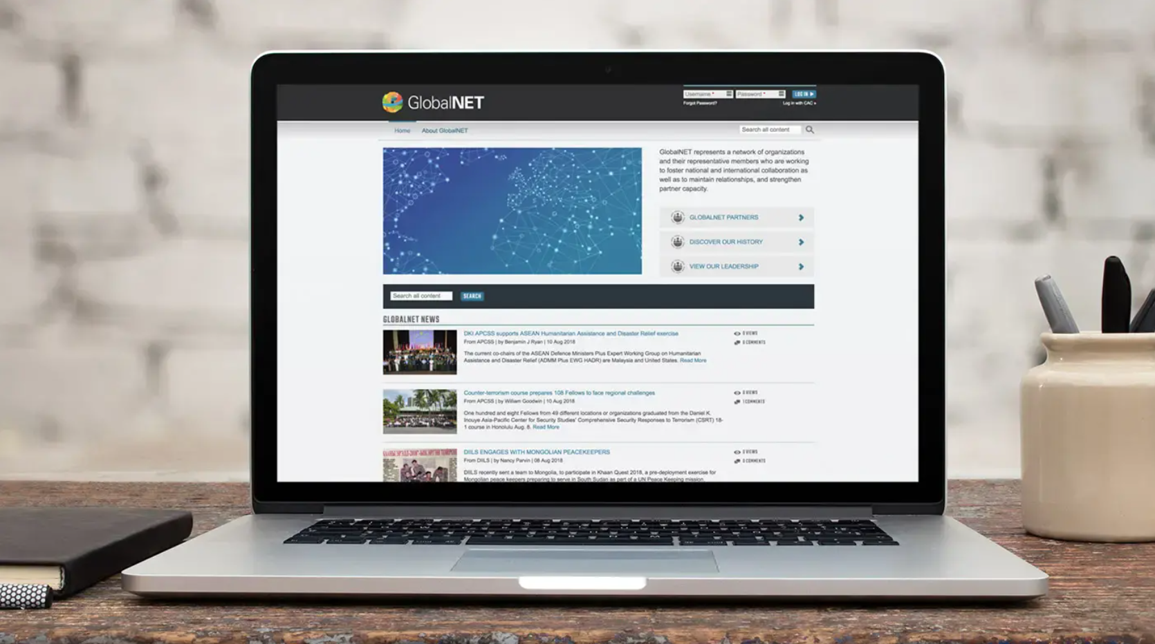 The homepage of the GlobalNET platform, displayed on a laptop