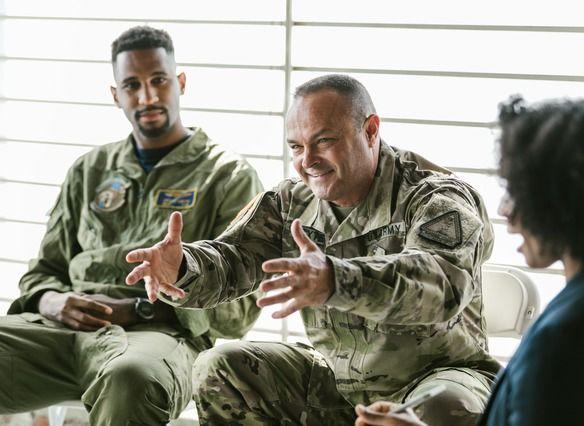 3 Veterans in uniform talking together