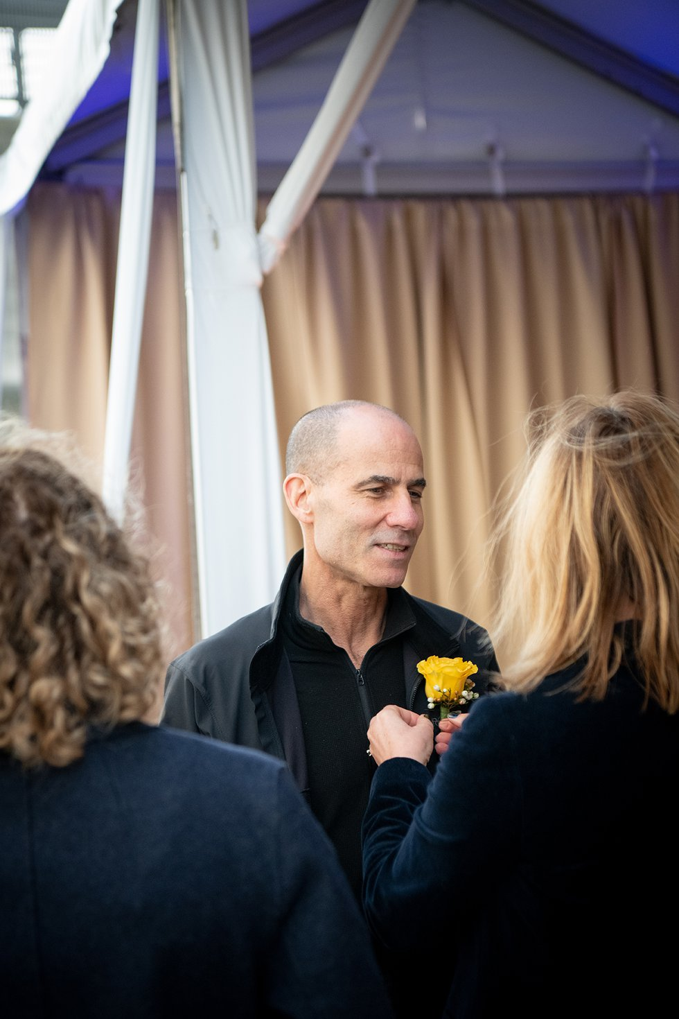 Photo of Terry Rosen talking to other guests