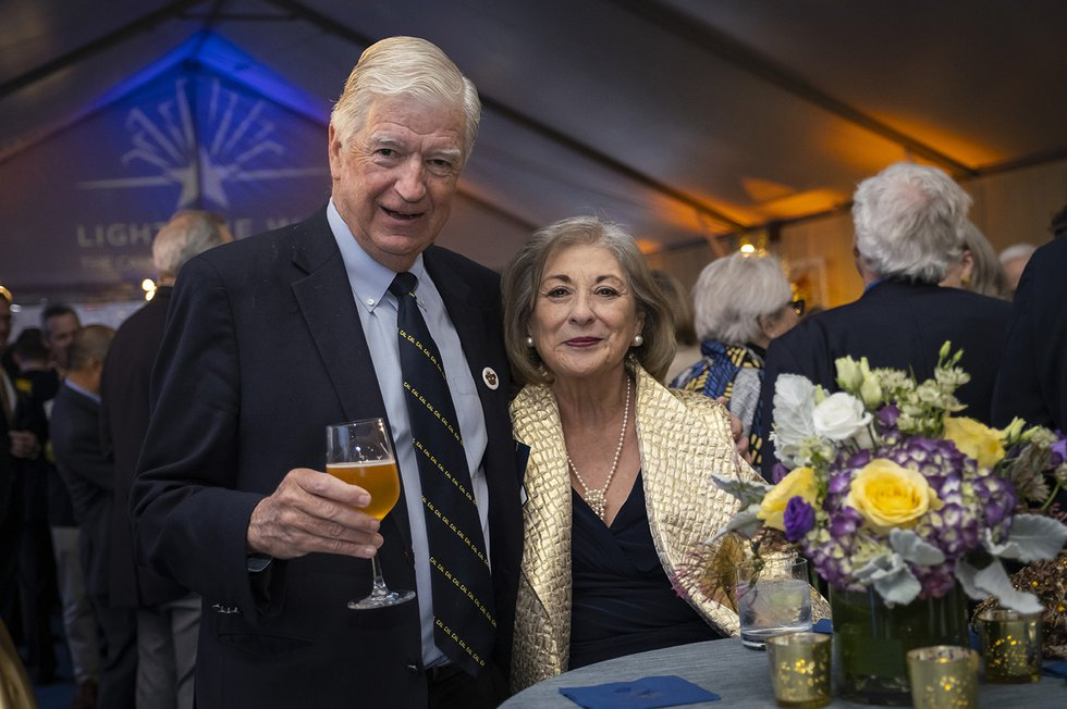 Photos of two guests looking at the camera, with one toasting the camera with his drink