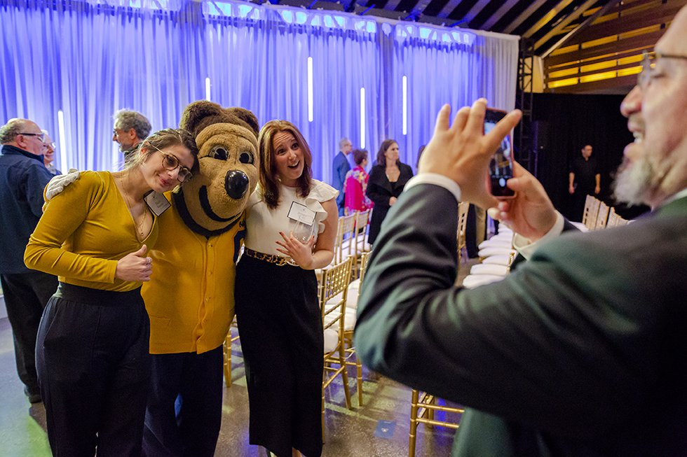Photo of  Delila Robledo and friend posing with Oski.
