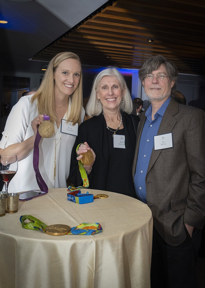 Photo of Dana Vollmer and two guests holding Olympic medals