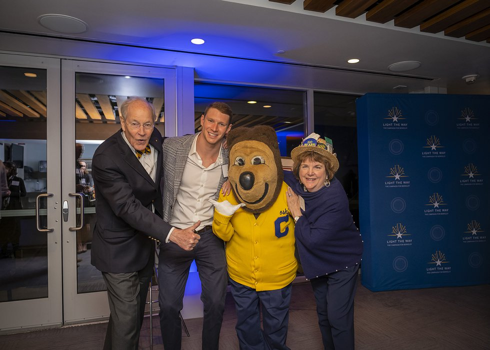 Photo of two guests posing with Ryan Murphy and Oski