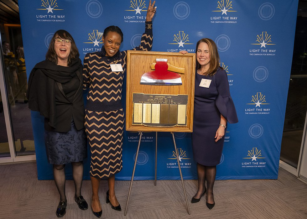 Photo of Michelle McLellan, Leti Light, and Julie Hooper posing with the Stanford Axe