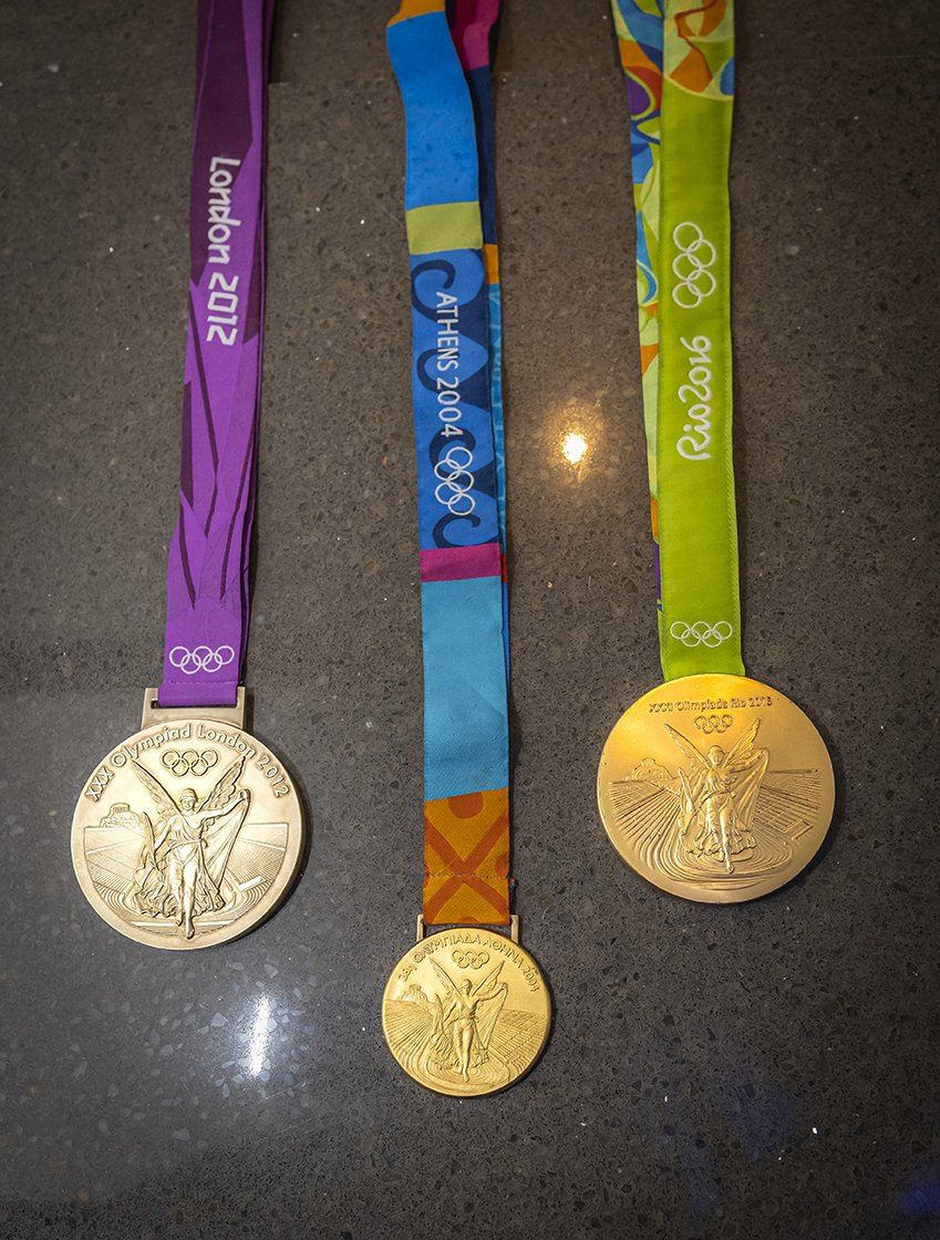 Photo of Olympic medals from 2012, 2014, and 2016