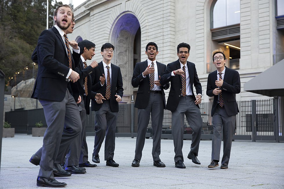 Photo of an a cappella singing group performing outside Memorial Stadium