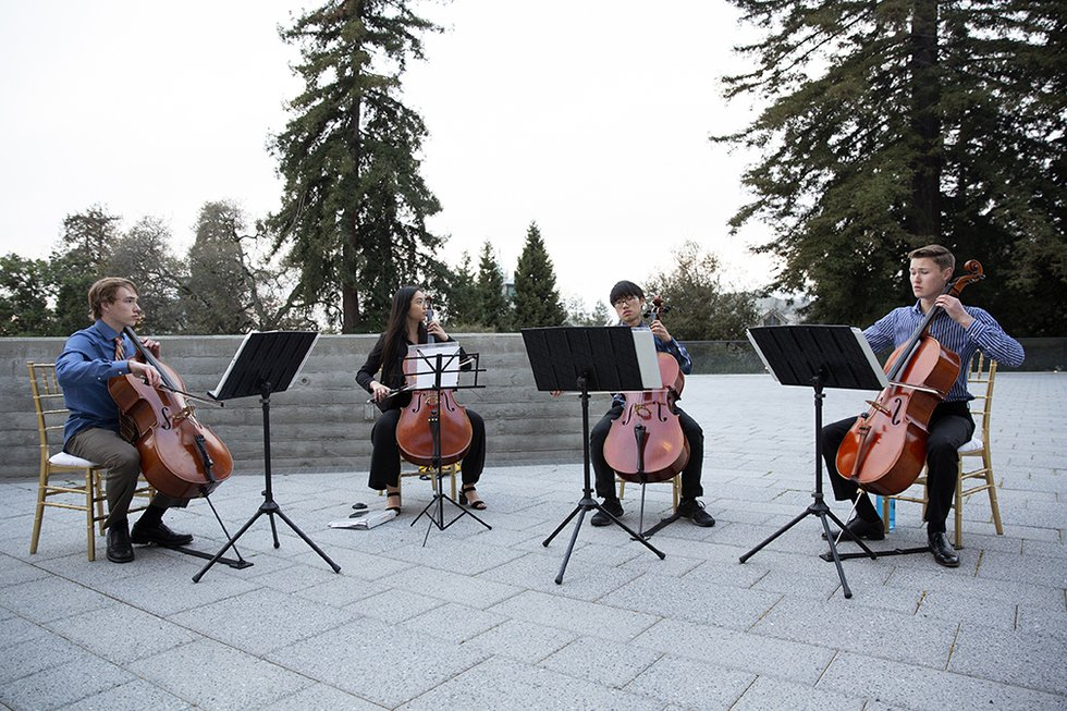 Photo of a student group playing cellos