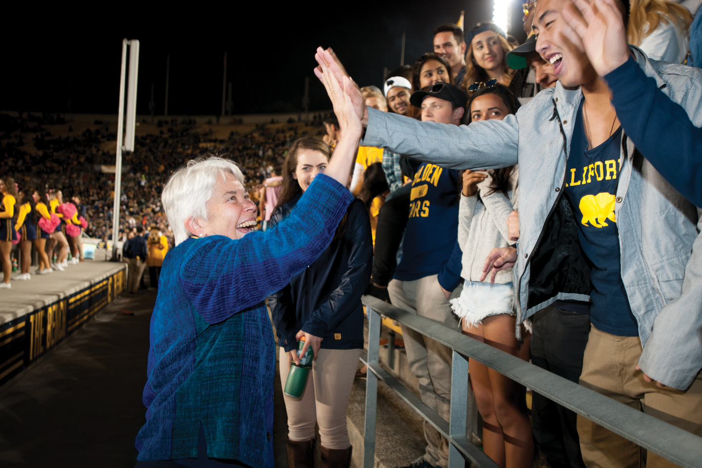 Photo of Chancellor Christ greeting her most exuberant fan club — students.