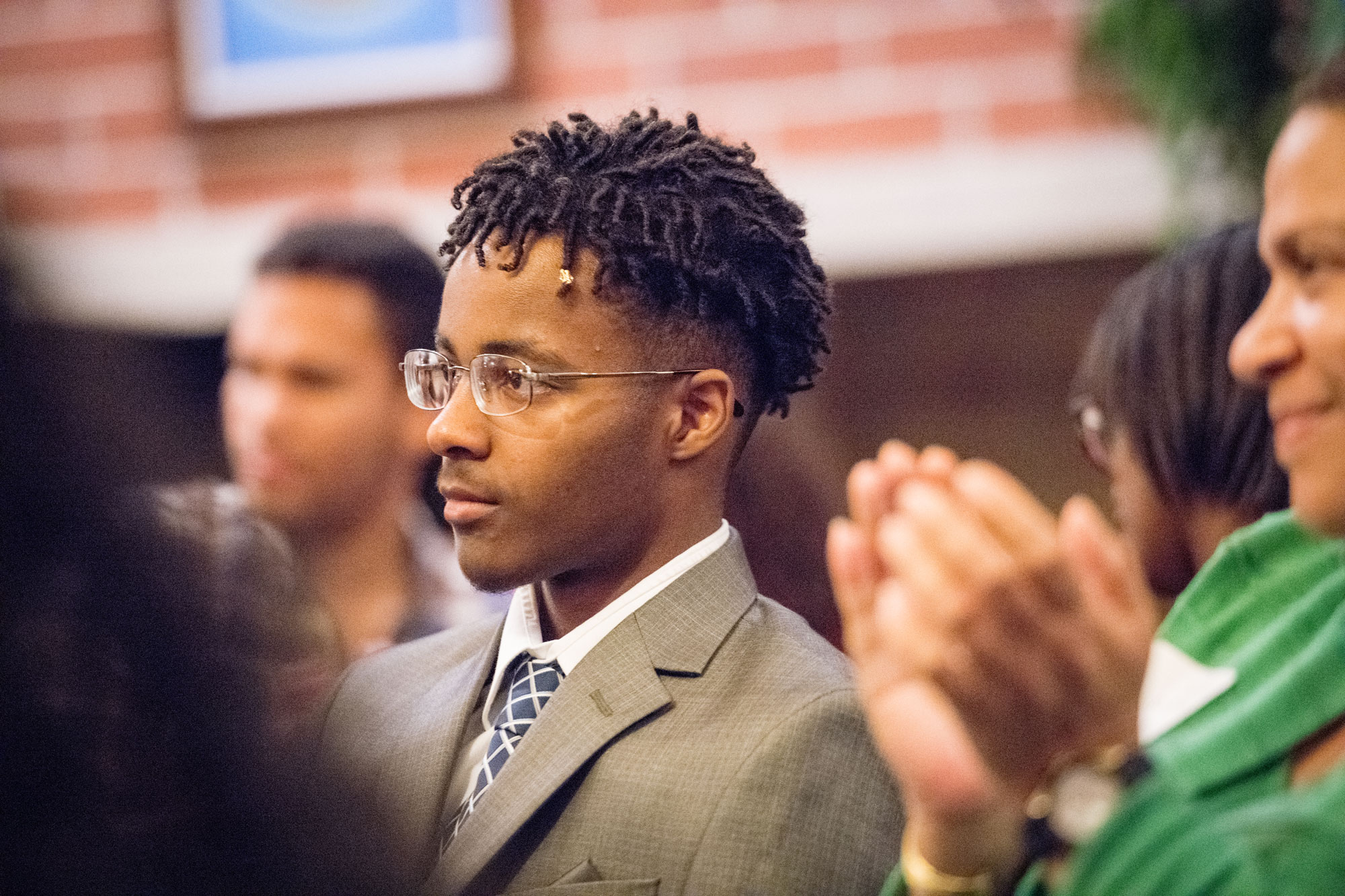 Photo of William Parker listening to remarks during a reception for the scholarship recipients.