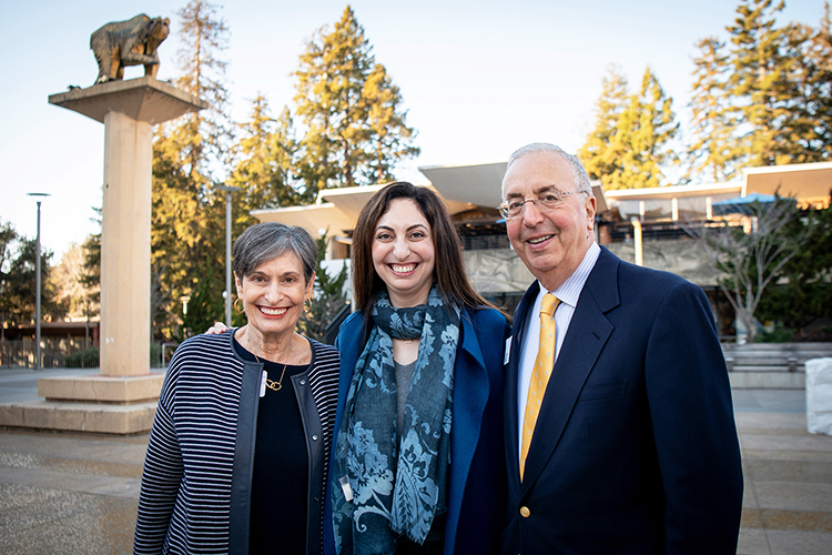 Photo of the Haas family on campus, smiling into the camera