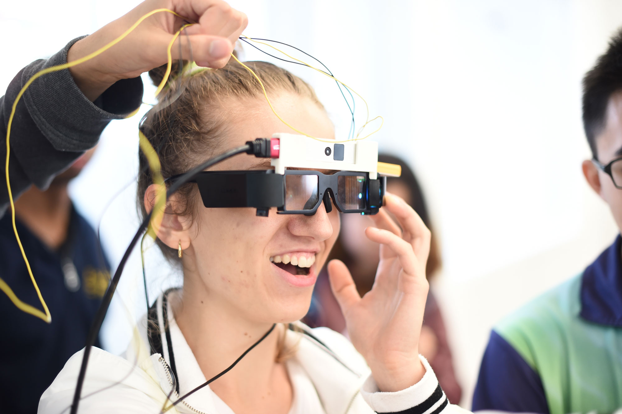 Photo of a student smiling and wearing tech glasses