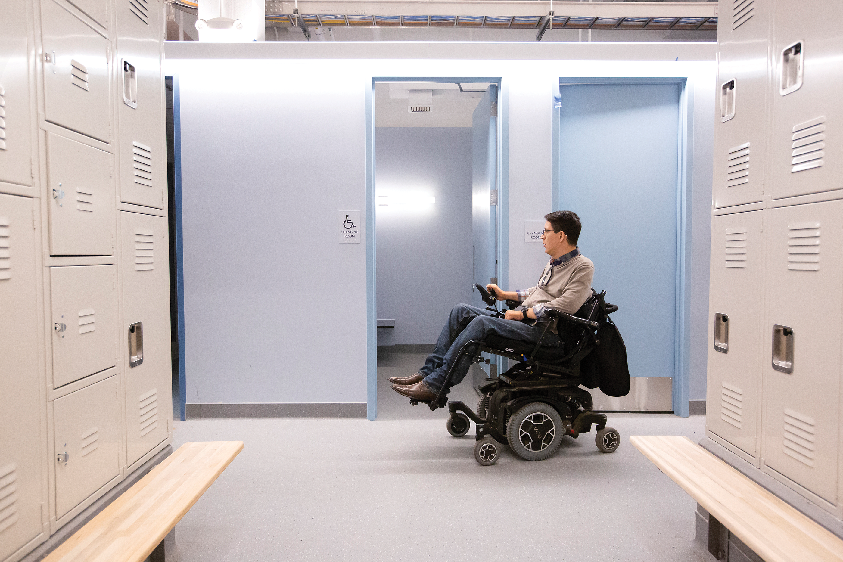 Photo of Ben Perez '13, who uses a wheelchair, in the new locker room, which is more accessible and more private.
