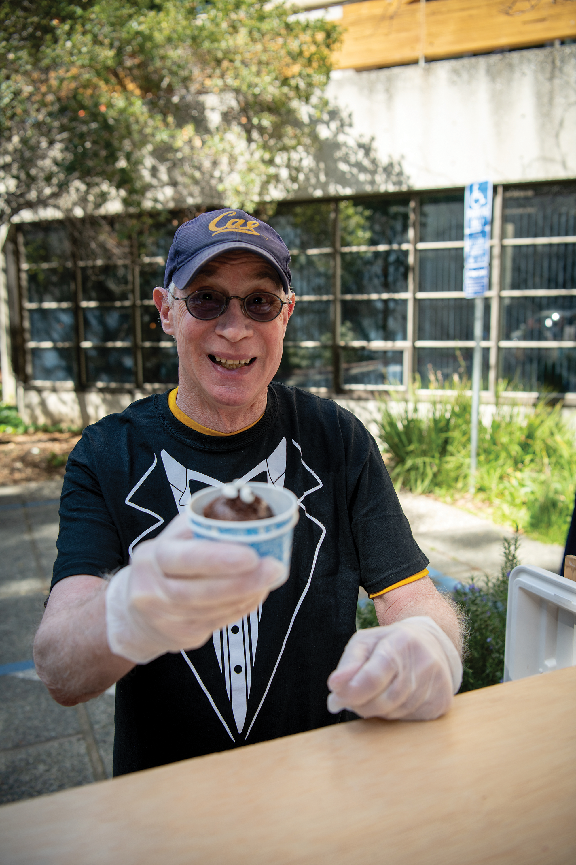 Michael G. Harris doles out ice cream with a smile.