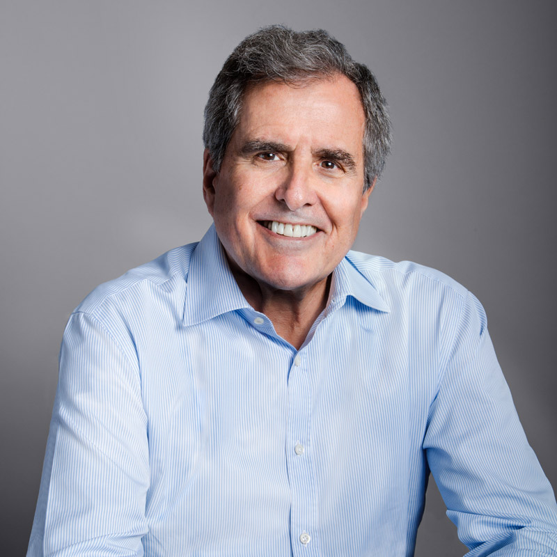 Photo of Peter in a blue shirt against a gray background