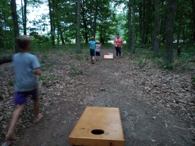 plying Corn Hole at kalhavenoutpost campgrounds group site.